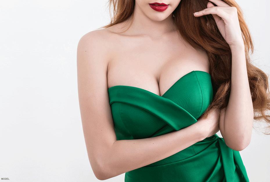 Women pleased with her breast augmentation procedure in Toronto.